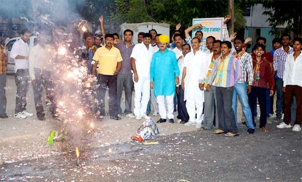 Rajawat and followers celebrating announcement of Modi as BJP PM Candidate