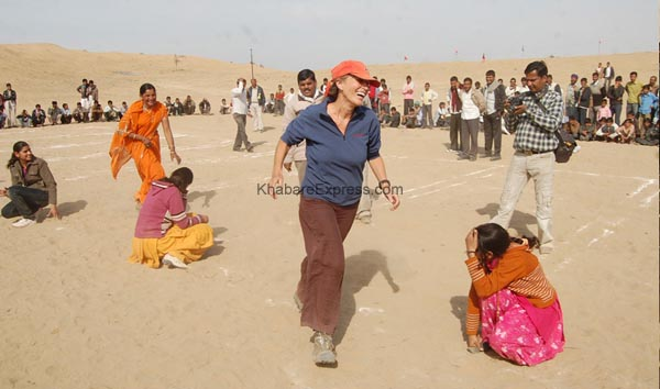 Foreigners  enjoying  Kho_Kho - competition at laderan Village during Camel Festival 2011