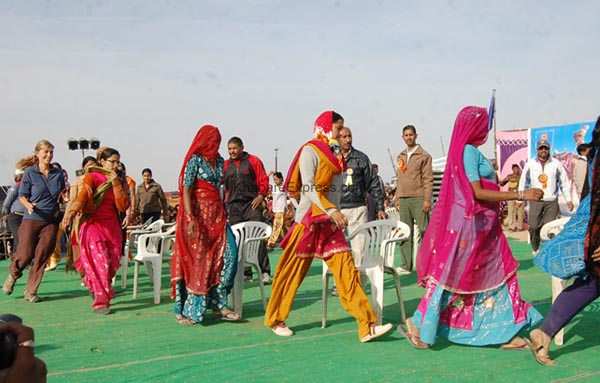 Foreigners enjoying musical chair - competition at laderan Village during Camel Festival 2011
