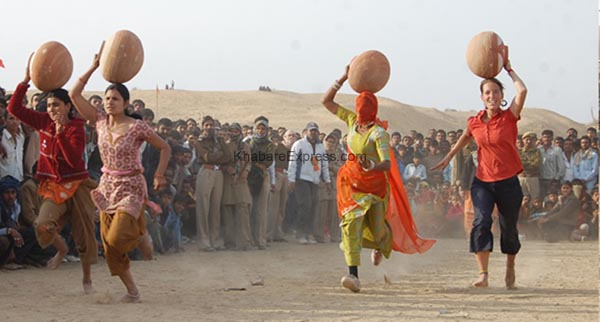 Foreigners enjoying in Mataka Daud - competition at laderan Village during Camel Festival 2011