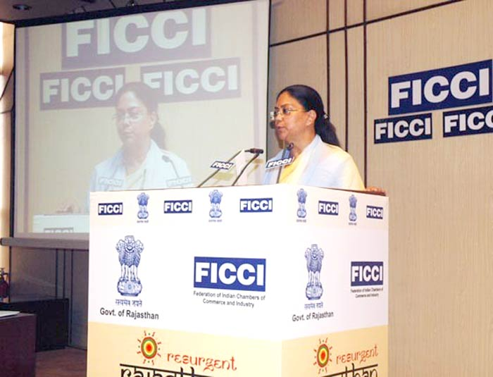 Rajasthan Chief Minister Ms. Vasundhara Raje releasing Resurgment Rajasthan dot com website at FICCI