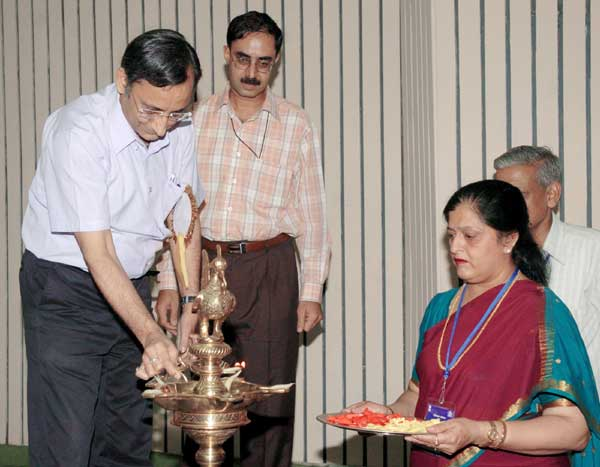 The Addl. Secretary (S & V) Ministry of Personnel, Shri Rahul Sarin lighting the lamp to inaugurate