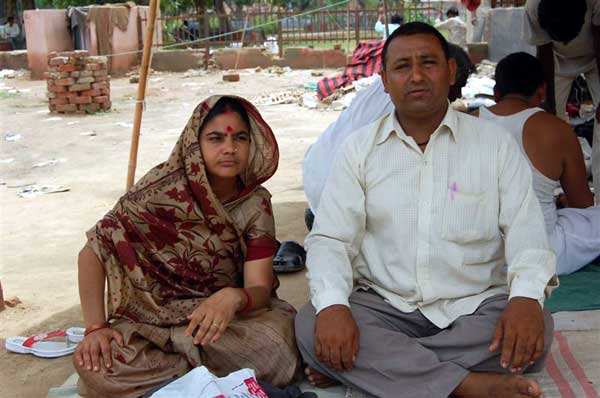 Fired couple Ashok and Mrs Saroj from Engineering College, Bikaenr still on agitation at Collectrate