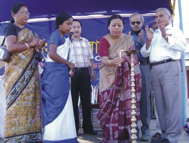 The Sabhadhipati, Siliguri Mahakuma Parishad Smt. Moni Thapa, lighting the lamp to inaugurate the PI