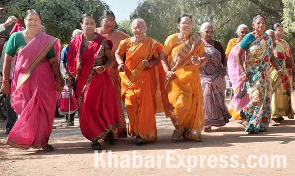 Senior citizen women participating in a marathon to mark the International Day of Older Persons