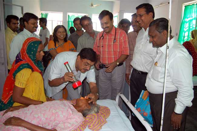 Dr Om Acharya in medical camp for the Free Eye Inspection and Free Opticals