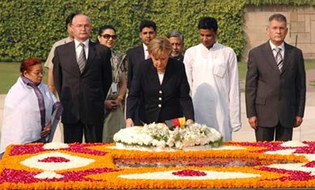 The Chancellor of Germany, Ms. Angela Merkel laying wreath at the Samadhi of Mahatma Gandhi at Rajgh