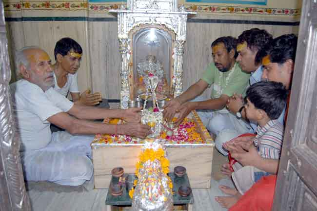 Pray offered to Lord Shiva with Silver Page (Chandi Work)