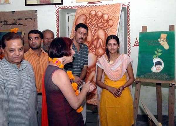 International Artist Sujan Thomas watching paintings made Bikaneri Artists at Rampuria College