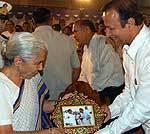 Virendra Beniwal at their resident presents Usta Art Golden Frame to Smt Kamla -Governor of Gujarat