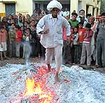 Holi celebration in PIC � Walk on Fire during on Holi Fir Ritual at Banswara