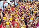 Women during Kalash Yatra to initiate Dhanvarsha Laxmi Mahayagya at Bikaner
