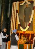 The Prime Minister, Dr. Manmohan Singh paying homage at the portrait of the first President of India
