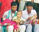 family of the woman deceased during sterilisation camp performaning at collector office for more aid