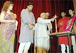 Governor SK Singh lighting the lamp of Pinaz Masani Music Night to help Bihar flood victims