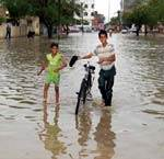Children enjoying Rain in Bikaner