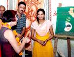 International Artist Sujan Thomas watching paintings made Bikaneri Artists at Rampuria College