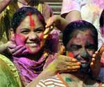 Holi celebration in PIC � Girls coloring each other