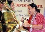 President Pratibha Patil awarded to MAND Singer Mangi Bai Arya in New Delhi