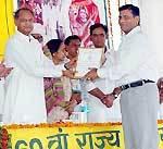 O P Sharma recieving honour of Vaniki Lekhan from CM Ashok Gehlot