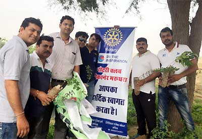 Rotarians and HDFC Bank employee during Tree Plantation